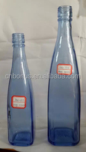 customized blue glass tequila bottle