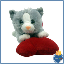 red silk ribbon tied toy cat catching the heart baby toy