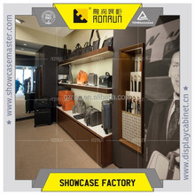 Garment store furniture with leather bag and leather belt display cabinet in city center plaza