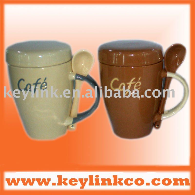 handpainted ceramic coffee mug with spoon and cover