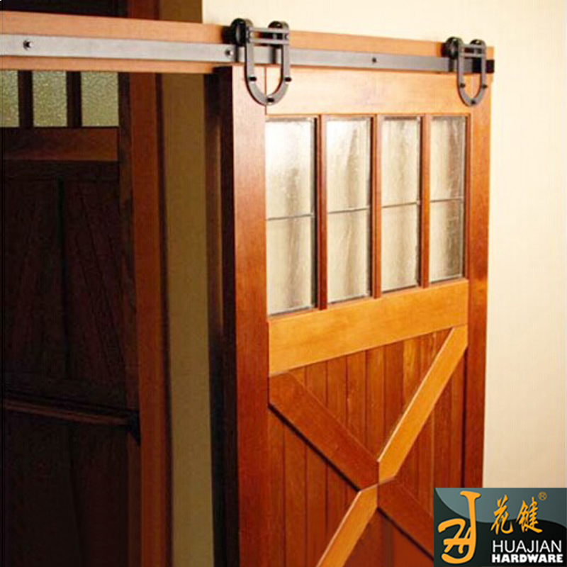 Interior wooden hanging modern sliding barn door hardware for Hanging a sliding barn door