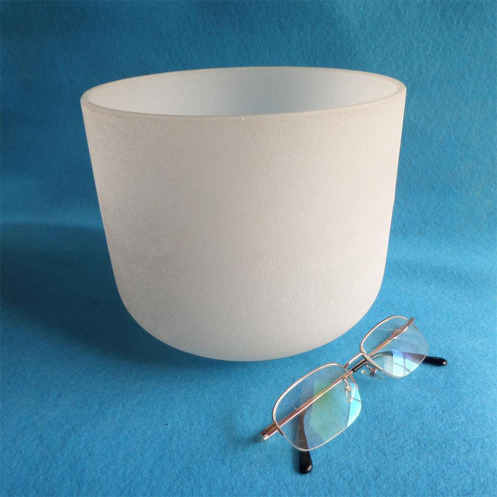 A quartz singing bowl with seven tones of frosted crystal