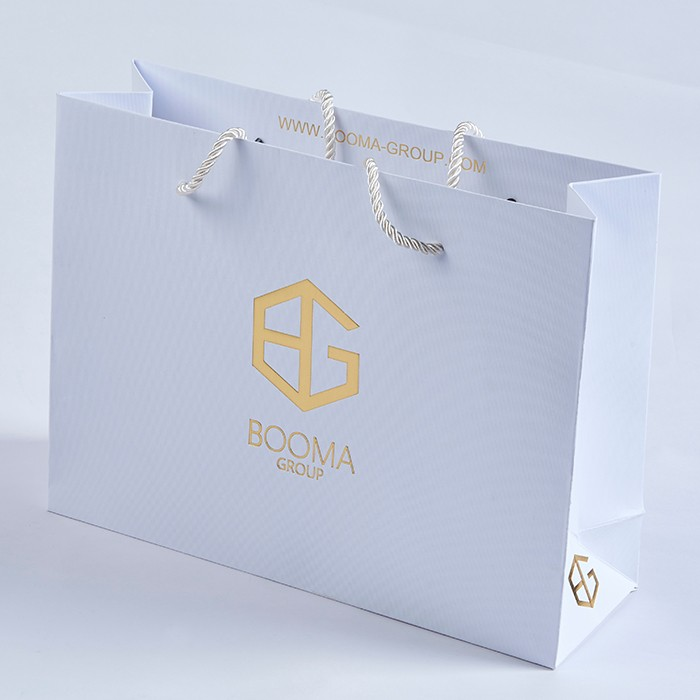Trendy reusable shopping paper bags with logos