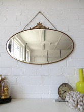 Wholesale metal frame gold brushed oval decorative wall hanging mirror with chain for sales