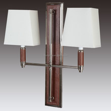 Polished Nickel and Faux Brown Leather Double Wall Sconce for hotel guestrooms
