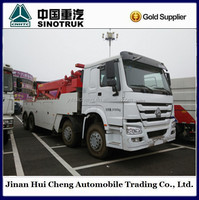 Sinotruck howo rotator wrecker towing truck 8*4 for sale