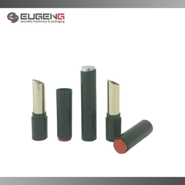 round black empty lipstick tube with red top