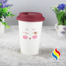 Thermal porcelain coffee cup with silicone lid