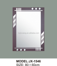 carved wooden frame mirror