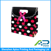 Luxury dot design printed gift bag for kids , lovely gift paper bag with bowknot