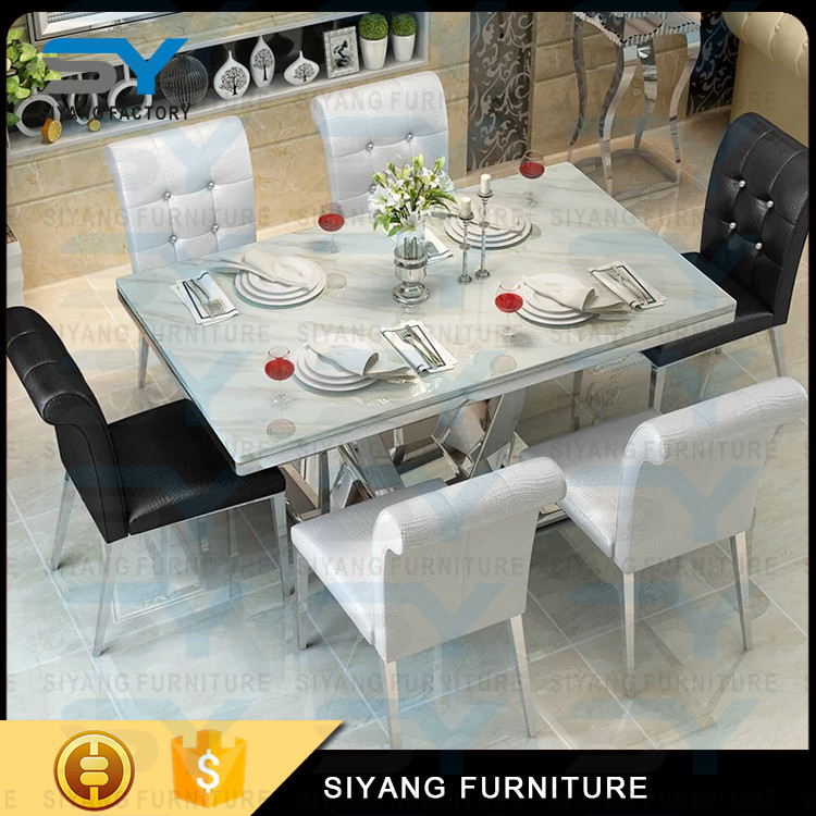 Hand carve metal frame travertine marble dining table with V shaped stand CT010