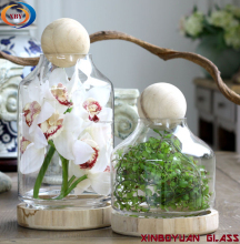Clear glass flower vases with wood base