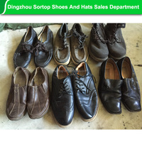 Alibaba Wholesale china guangzhou second hand shoes, mens leather shoes used sport shoes.
