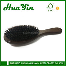 Wooden hair comb with brister massage brush