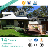 prefabricated steel frame villa with grassland and carport