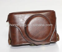 Brown leather camera bag with strap