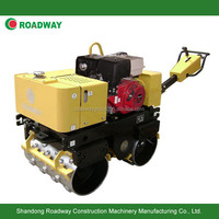 vibratory tamping roller with cam
