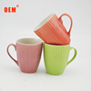 Factory direct sale cheap color glazed embossed ceramic mug