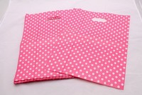 pink and white dotted gift plastic bag
