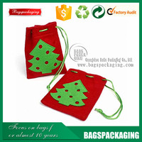 red hand made small drawstring felt bag with green tree logo