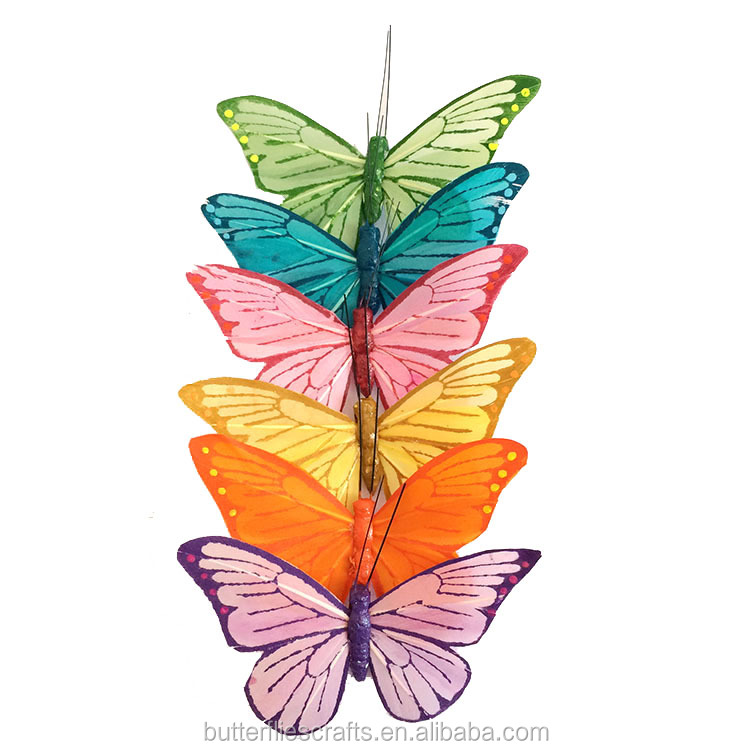 Brightly colored real feather butterfly for holiday decorations