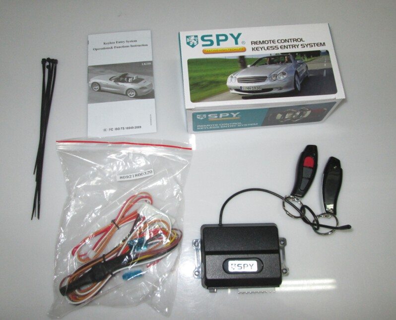 Keyless entry system with two remotes, trunk release, window rolling up