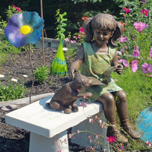 bronze statue of girl reading book with dog for garden decorative