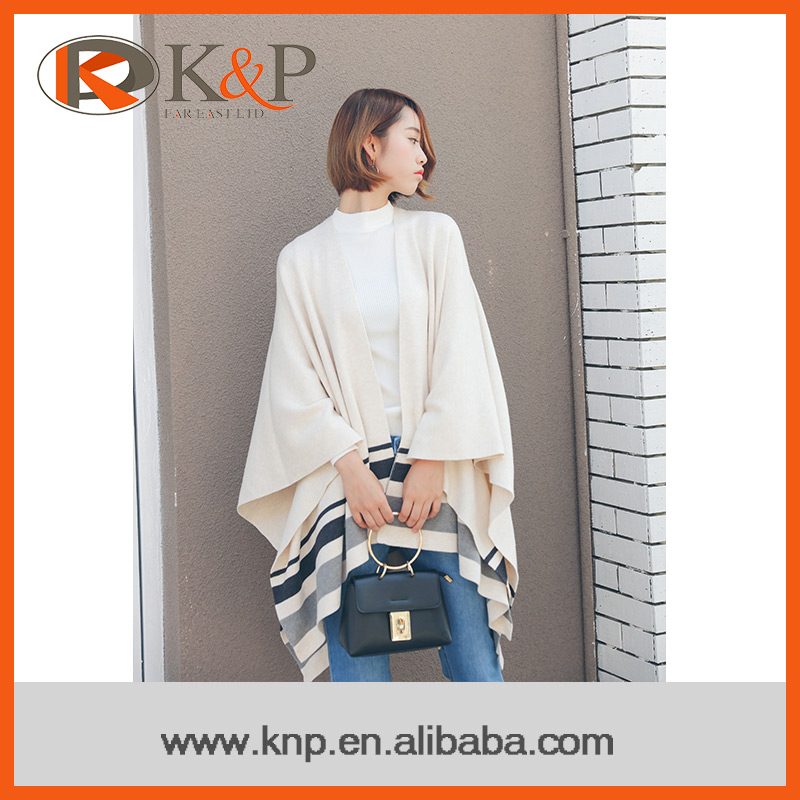 Adult wearing comfortable beige grey knit sweater long sleeve shawl
