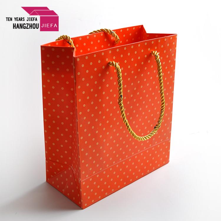 Wholesale unique paper shopping bag for clothing