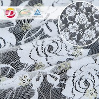 2016 new fancy cheap stretch embroidery sequin and beaded tulle fabric