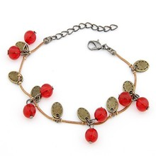 Fashion bright red fruits cherries, hand catenary Retro