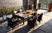 Aluminum frame outdoor furniture wicker dining table and chairs.
