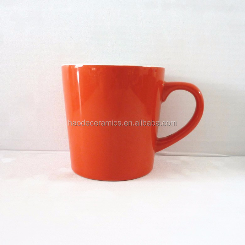 [ ZIBO HAODE CERAMICS]passionate two-tone V-shape white/orange ceramic mug customzied logo