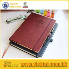 notebook with pen attached