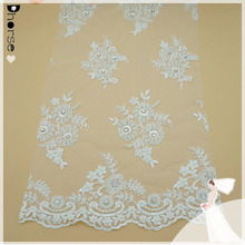 Elegant wholesale bridal guipure lace fabric market in Dubai /bridal wedding dress mesh beaded lace fabric