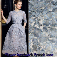 Latest 3d flower fabric lace dress pattern/hand embroidery net fabric for GANA show