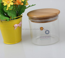 china manufacturer wholesale cheap food safe grade clear glass storage bottles & jars decal container with bamboo lid
