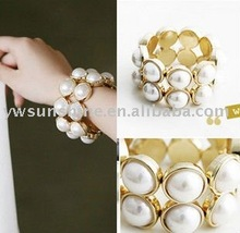 Gold plated bangle with pearl stone