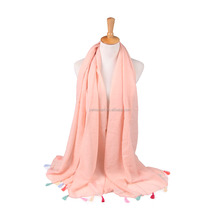 BSCI yiwu factory plain dyed solid with colorful tassel fashion lady beach pashmina shawl custom wholesale scarf