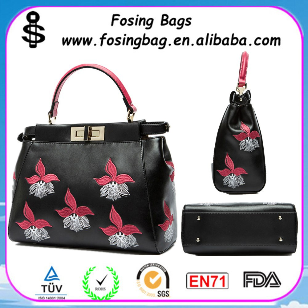 Embroidered orchid kitten ethnic charm personalized middle-aged shoulder brand handbag wholesale