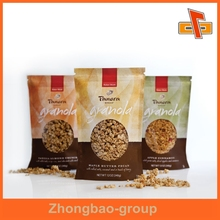 Guangzhou manufacturer plastic stand up punching bag for granola packaging with zipper
