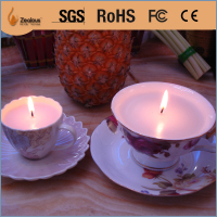 summer citronella fragrant candle in coffee cup