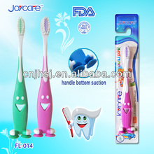 Children smile toothbrush with suction bottom