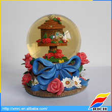 Nature flower pedestal tourist souvenirs snow globes with house