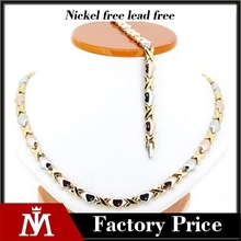 Fashion hot sale titanium X and heart necklace stainless steel tri tone jewelry set