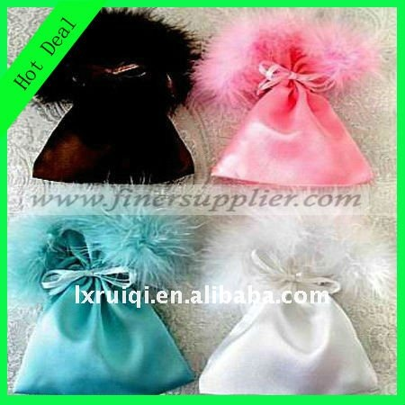 satin drawstring pouch with feather