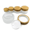 /product-detail/wholesale-skin-care-5ml-15ml-30ml-50ml-100ml-clear-frosted-empty-bamboo-lid-glass-cosmetic-packaging-face-cream-jar-62091722794.html