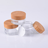 /product-detail/50g-custom-glass-jars-bamboo-lid-100ml-cosmetic-airless-glass-jar-cosmetic-white-60782149409.html