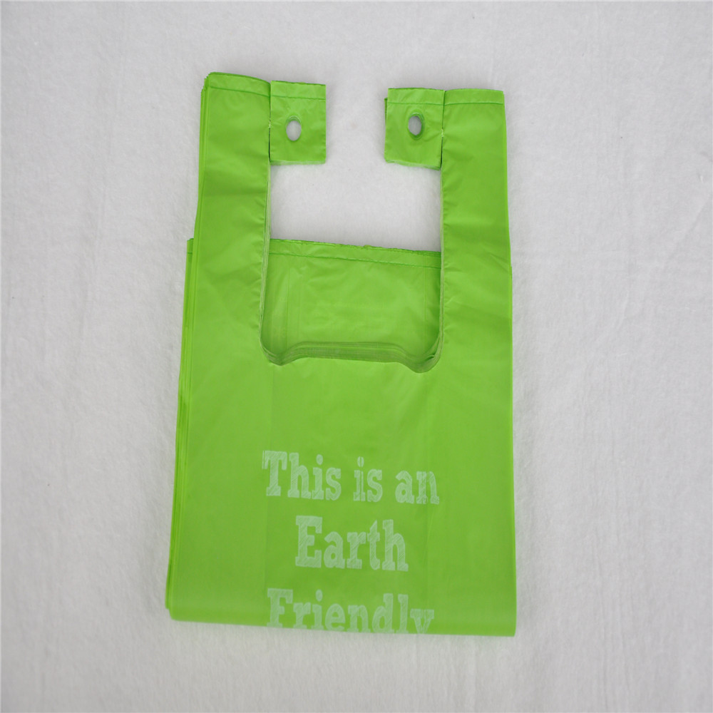 Compostable cornstarch t-shirt and perforated between bags