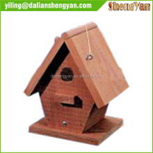 A single unique wooden bird house